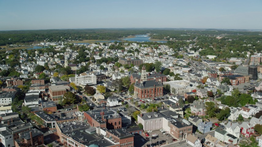 Fly by city hall in a residential neighborhood, Gloucester, Massachusetts Aerial Stock Footage | AX147_104
