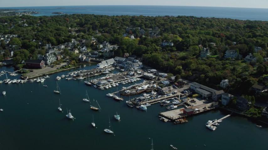 6k stock footage aerial video flying over marina toward coastal town, Gloucester, Massachusetts Aerial Stock Footage | AX147_105