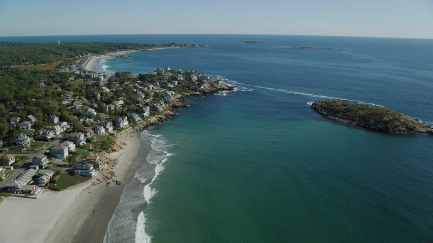 Flying by oceanfront homes, Gloucester, Massachusetts Aerial Stock Footage   AX147_108