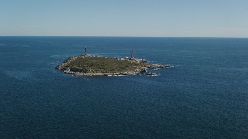 6k stock footage aerial video approaching an island with two lighthouses, Thatcher Island, Massachusetts Aerial Stock Footage   AX147_109