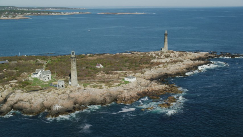 6k stock footage aerial video orbiting two lighthouses on Thatcher Island, Massachusetts Aerial Stock Footage   AX147_111
