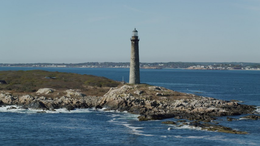 6k stock footage aerial video orbiting a lighthouse on Thatcher Island, Massachusetts Aerial Stock Footage   AX147_112