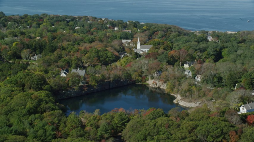 Fly by church in a small coastal town, autumn, Gloucester, Massachusetts Aerial Stock Footage | AX147_132
