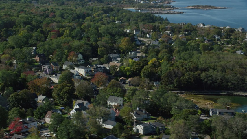 6k stock footage aerial video of a small coastal town among trees in autumn, Gloucester, Massachusetts Aerial Stock Footage | AX147_133