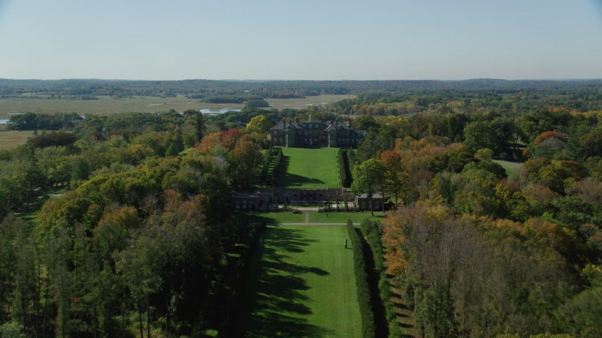 6k stock footage aerial video revealing The Great House at Crane Estate from water, autumn, Castle Hill, Ipswich, Massachusetts Aerial Stock Footage | AX147_139