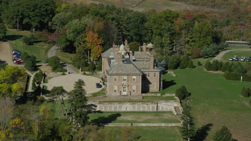 6k stock footage aerial video orbiting The Great House at Crane Estate and Castle Hill in autumn, Ipswich, Massachusetts Aerial Stock Footage | AX147_142