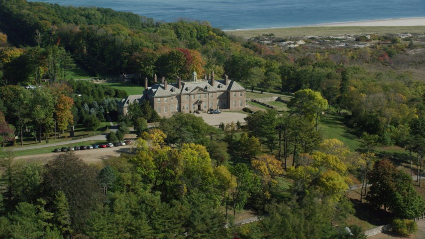 6k stock footage aerial video flying away from The Great House at Crane Estate and Castle Hill in autumn, Ipswich, Massachusetts Aerial Stock Footage | AX147_146