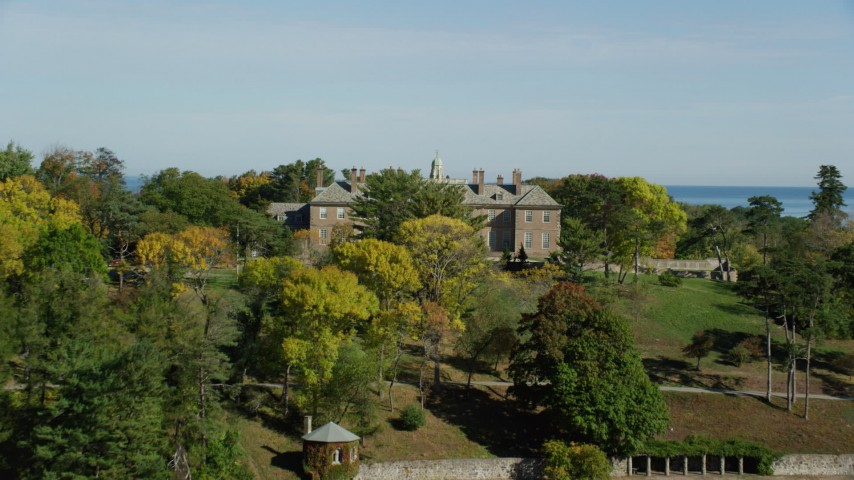 6k stock footage aerial video approaching The Great House at Crane Estate in autumn, Castle Hill, Ipswich, Massachusetts Aerial Stock Footage | AX147_148