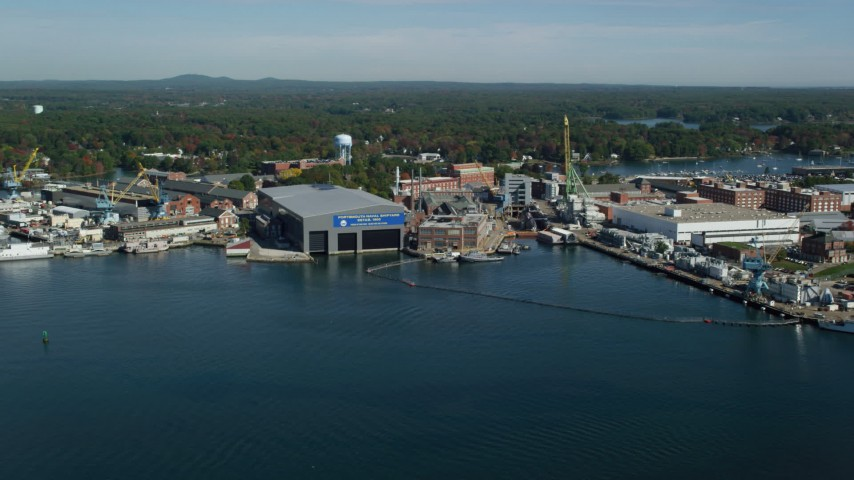 6k aerial video flying by a naval shipyard in autumn, Kittery, Maine Aerial Stock Footage | AX147_174