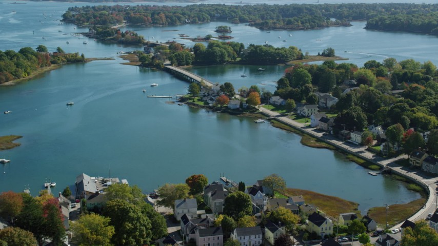 6k stock footage aerial video flying over small bridge, waterfront homes in autumn, Portsmouth, New Hampshire Aerial Stock Footage   AX147_186