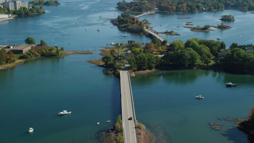 6k stock footage aerial video flying over small bridge and waterfront homes in autumn, Portsmouth, New Hampshire Aerial Stock Footage   AX147_187