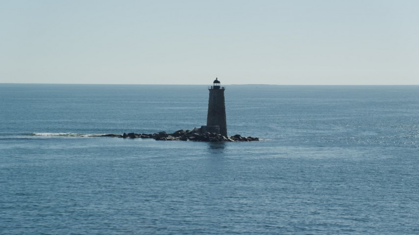 6k stock footage aerial video approaching a lighthouse in the middle of the water, Kittery, Maine Aerial Stock Footage AX147_194