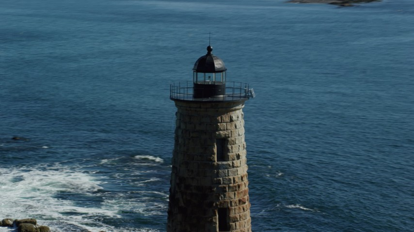 6k aerial video approaching and orbiting a lighthouse in the water, Kittery, Maine Aerial Stock Footage | AX147_195