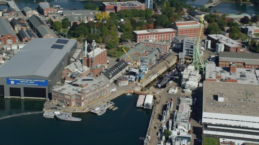 6k stock footage aerial video flying by Portsmouth Naval Shipyard, submarine, Kittery, Maine Aerial Stock Footage | AX147_202