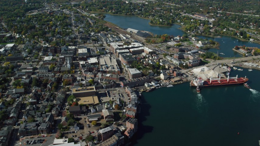 6k stock footage aerial video flying by coastal town and a cargo ship in autumn, Portsmouth, New Hampshire Aerial Stock Footage   AX147_203
