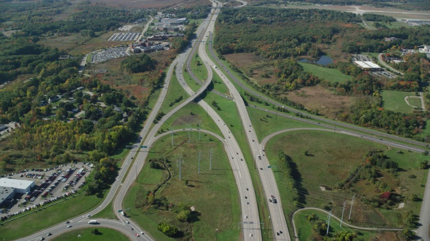 6k stock footage aerial video flying over Portsmouth Traffic Circle, interchanges, autumn, Portsmouth, New Hampshire Aerial Stock Footage   AX147_206