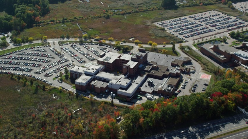 6k stock footage aerial video flying by Portsmouth Regional Hospital, autumn, Portsmouth, New Hampshire Aerial Stock Footage   AX147_208