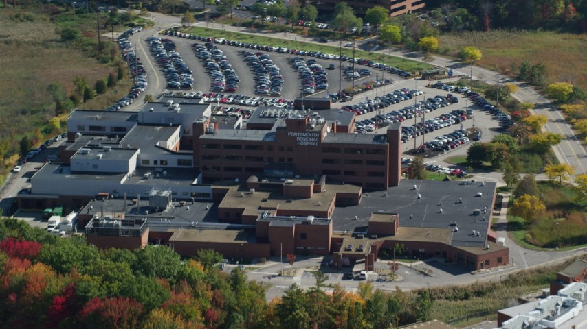 6k stock footage aerial video flying away from Portsmouth Regional Hospital, autumn, Portsmouth, New Hampshire Aerial Stock Footage   AX147_209
