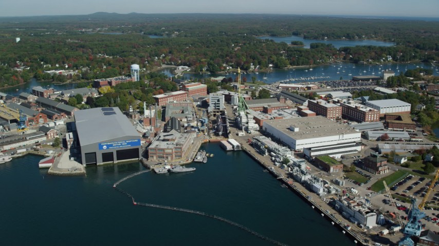 6k aerial video approaching Portsmouth Naval Shipyard, autumn, Kittery, Maine Aerial Stock Footage AX147_223