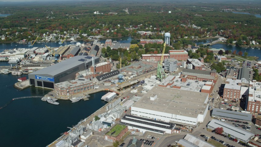 6k aerial video flying by Portsmouth Naval Shipyard, autumn, Kittery, Maine Aerial Stock Footage | AX147_224