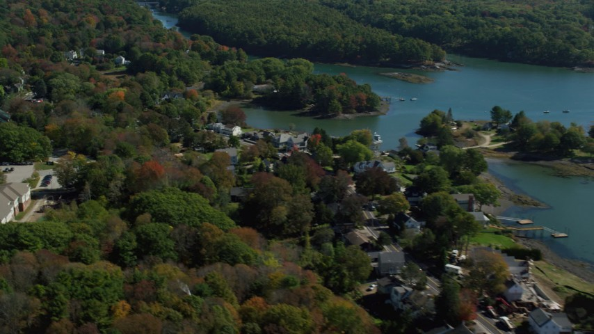 6k aerial video flying by waterfronts homes, colorful autumn trees, Kittery, Maine Aerial Stock Footage | AX147_227