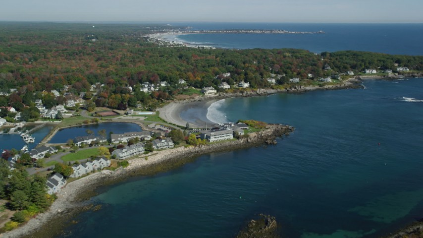 6k stock footage aerial video approaching small coastal town, York Harbor, beach, autumn, York, Maine Aerial Stock Footage | AX147_232