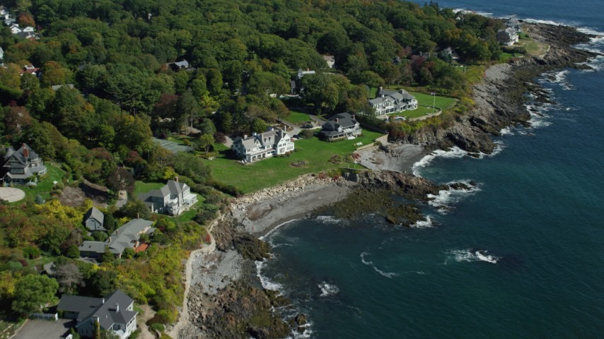 6k stock footage aerial video approaching upscale oceanfront homes, tilt down, autumn, York, Maine Aerial Stock Footage | AX147_233