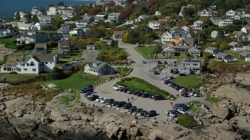 6k stock footage aerial video flying over Cape Neddick Light, approach coastal town, autumn, York, Maine Aerial Stock Footage | AX147_242
