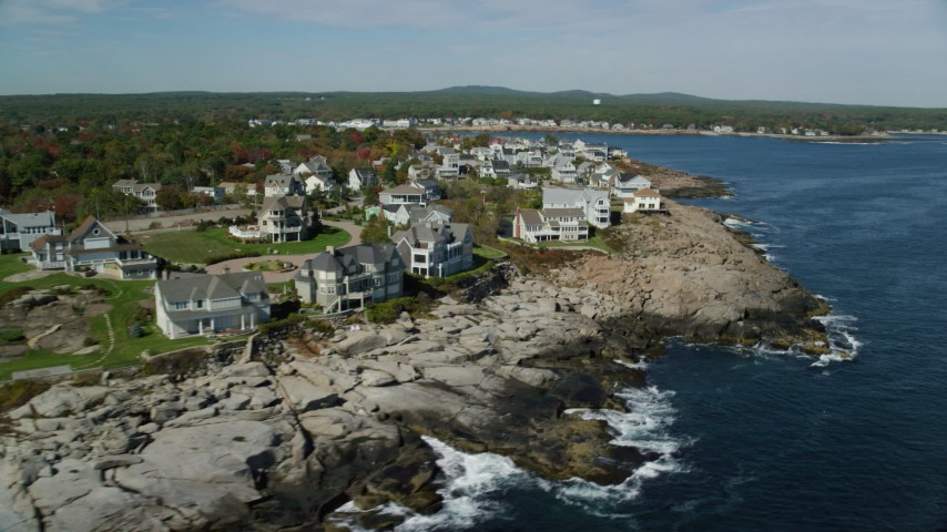 6k stock footage aerial video flying by oceanfront mansions, rocky coast, autumn, York, Maine Aerial Stock Footage | AX147_243