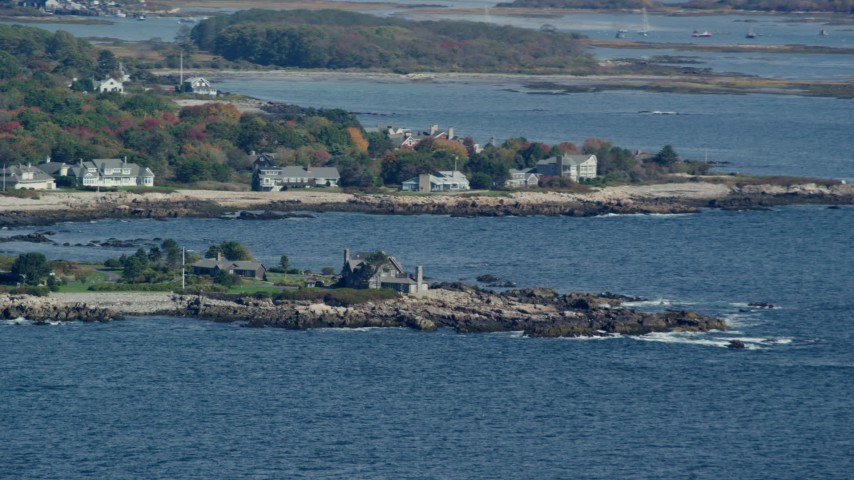 6k aerial video flying by Bush Compound, rocky coast, autumn, Kennebunkport, Maine Aerial Stock Footage | AX147_255