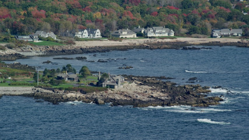 6k stock footage aerial video flying by the Bush Compound, rocky coastline, autumn, Kennebunkport, Maine Aerial Stock Footage AX147_256 | Axiom Images