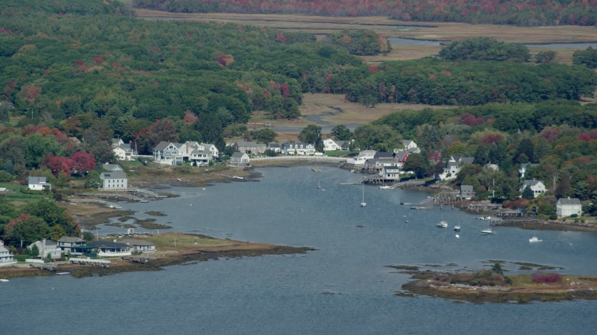 6k stock footage aerial video flying by waterfront homes, small cove, colorful trees, autumn, Kennebunkport, Maine Aerial Stock Footage | AX147_260
