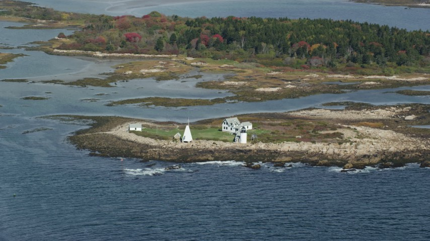 6k stock footage aerial video flying by Goat Island Light, autumn, Kennebunkport, Maine Aerial Stock Footage | AX147_261