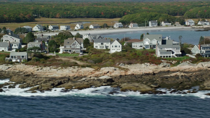 6k stock footage aerial video flying by oceanfront homes, autumn, Biddeford, Maine Aerial Stock Footage | AX147_265