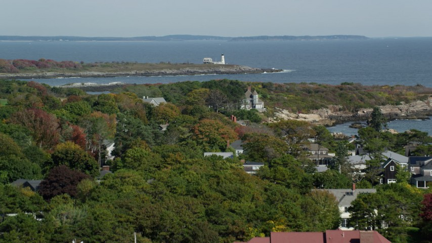 6k stock footage aerial video flying over coastal community, approach Wood Island Light, autumn, Biddeford, Maine Aerial Stock Footage | AX147_268