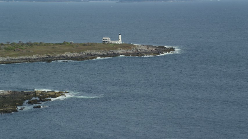 6k stock footage aerial video approaching Wood Island Light, autumn, Biddeford, Maine Aerial Stock Footage | AX147_269