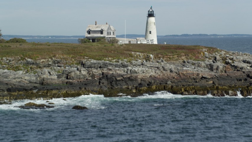 6k stock footage aerial video revealing and approaching Wood Island Light, autumn, Biddeford, Maine Aerial Stock Footage | AX147_270