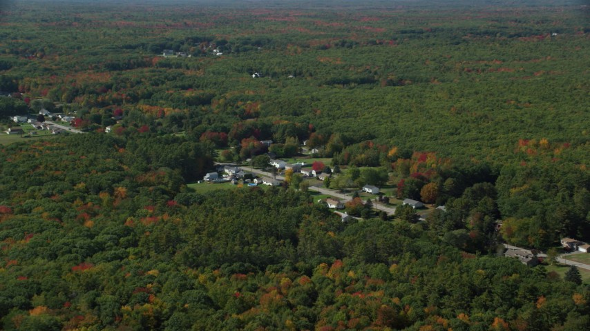 6k stock footage aerial video flying by rural homes off of Guinea Road, autumn trees, Biddeford, Maine Aerial Stock Footage | AX147_278