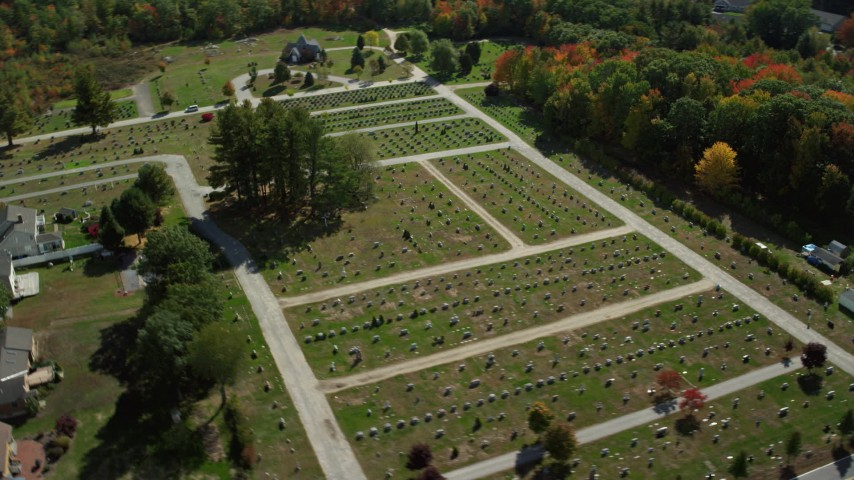 6k aerial video flying by a cemetery in autumn, Biddeford, Maine Aerial Stock Footage | AX147_280