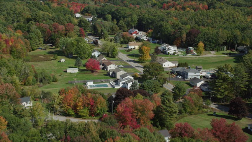 6k stock footage aerial video flying by rural homes, Guinea Road, autumn, Biddeford, Maine Aerial Stock Footage | AX147_291