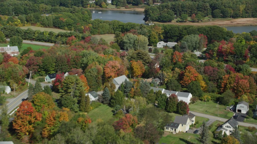 6k aerial video flying by rural homes, Guinea Road, Meeting House, Road, autumn, Biddeford, Maine Aerial Stock Footage | AX147_292