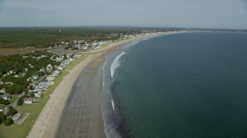 6k stock footage aerial video flying by a beach and coastal town, autumn, Old Orchard Beach, Maine Aerial Stock Footage | AX147_294