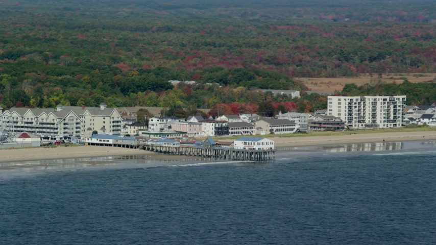 6k stock footage aerial video flying by beach and pier, colorful autumn trees, Old Orchard Beach, Maine Aerial Stock Footage | AX147_295