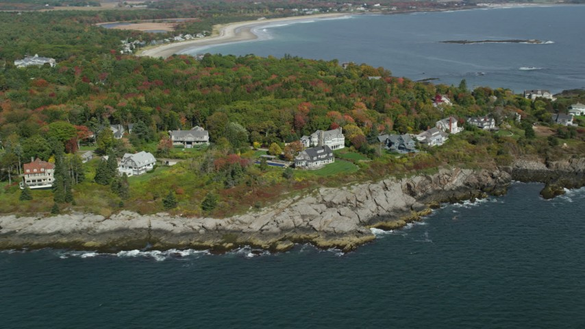 6k stock footage aerial video flying by oceanfront mansions, colorful trees in autumn, Scarborough, Maine Aerial Stock Footage | AX147_299