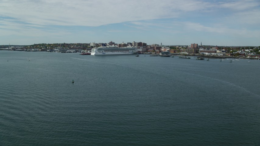 6k aerial video approaching a docked Norwegian Cruise Line cruise ship, Portland, Maine Aerial Stock Footage | AX147_321