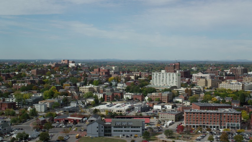 6k stock footage aerial video flying by apartments, office buildings, autumn trees, Portland, Maine Aerial Stock Footage | AX147_324
