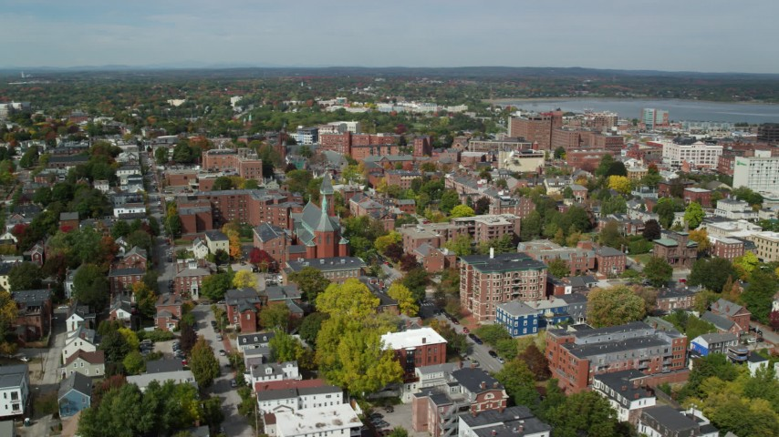 6k stock footage aerial video orbiting apartments, Saint Dominics Roman Catholic Church, autumn, Portland, Maine Aerial Stock Footage | AX147_326