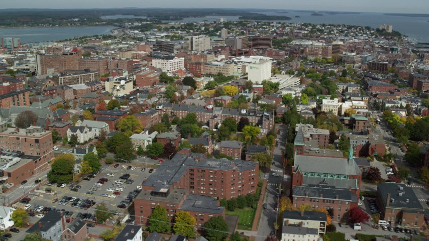 6k stock footage aerial video orbiting downtown, colorful autumn trees, Portland, Maine Aerial Stock Footage | AX147_327