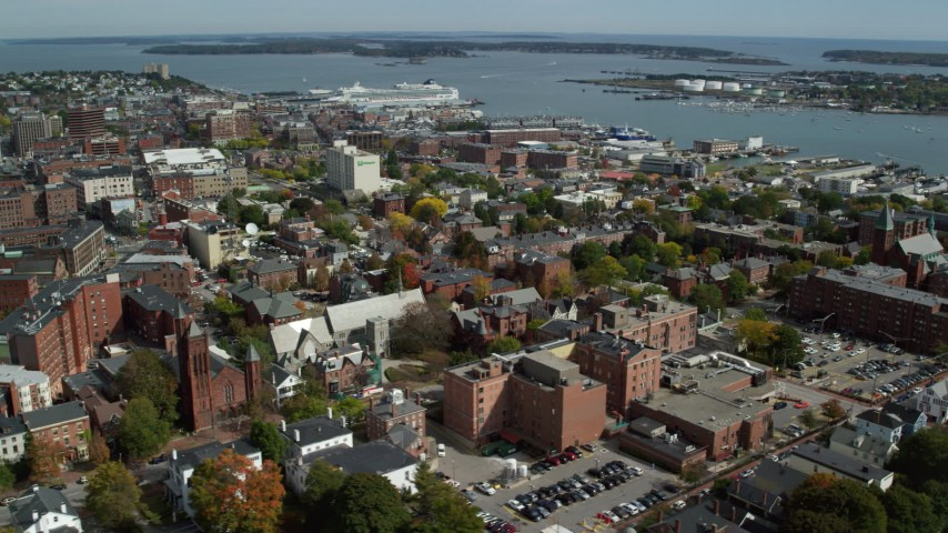 6k stock footage aerial video orbiting downtown, colorful autumn trees, Portland, Maine Aerial Stock Footage | AX147_328