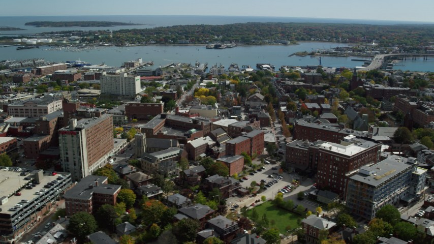6k stock footage aerial video orbiting Portland Harbor, downtown buildings, autumn, Portland, Maine Aerial Stock Footage | AX147_329